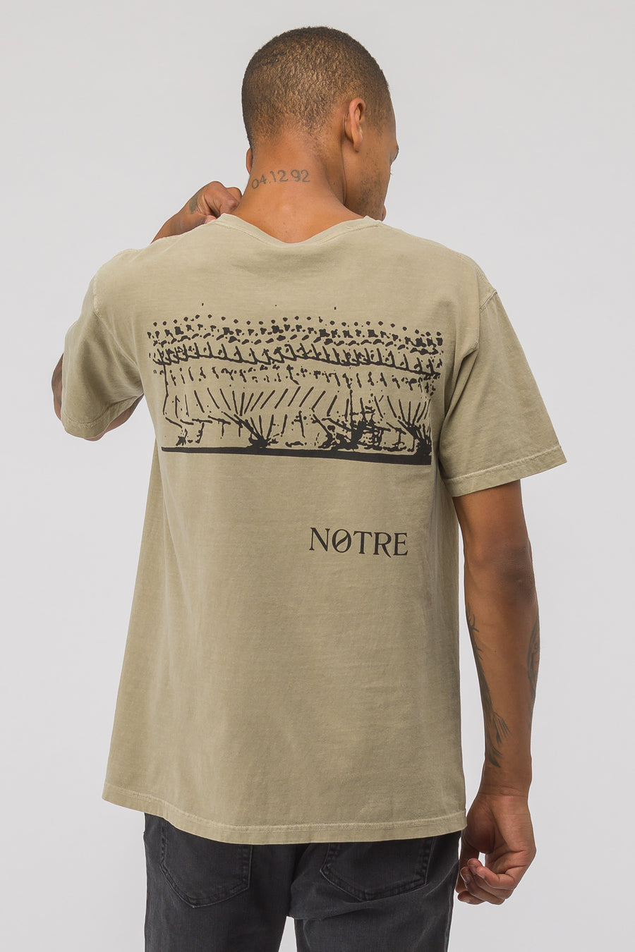 617a3bddc05 x Nike Stride Graphic Short Sleeve T-Shirt in Gold