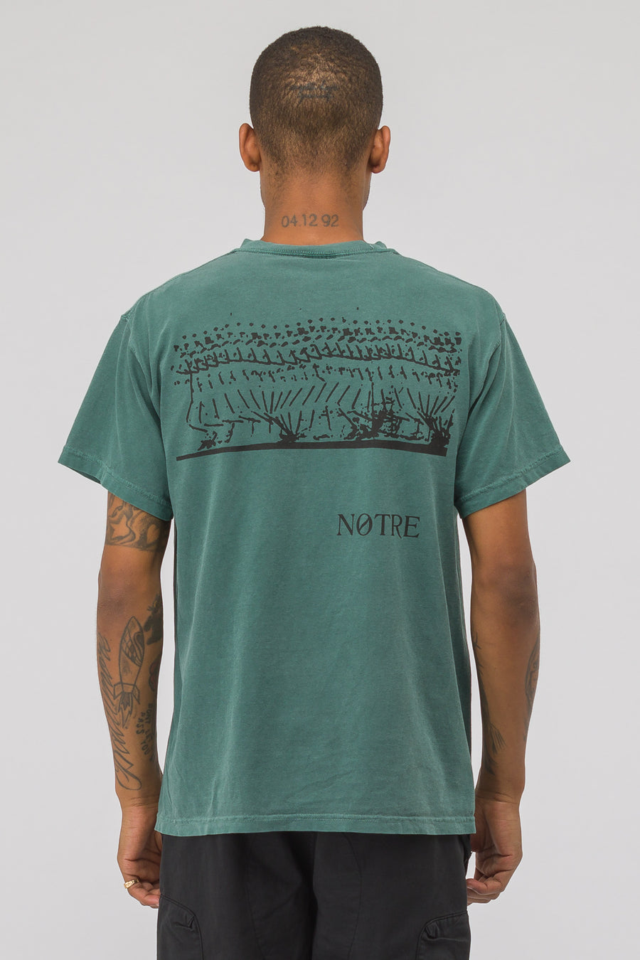 Notre x Nike Stride Graphic Short Sleeve T-Shirt in Green - Notre