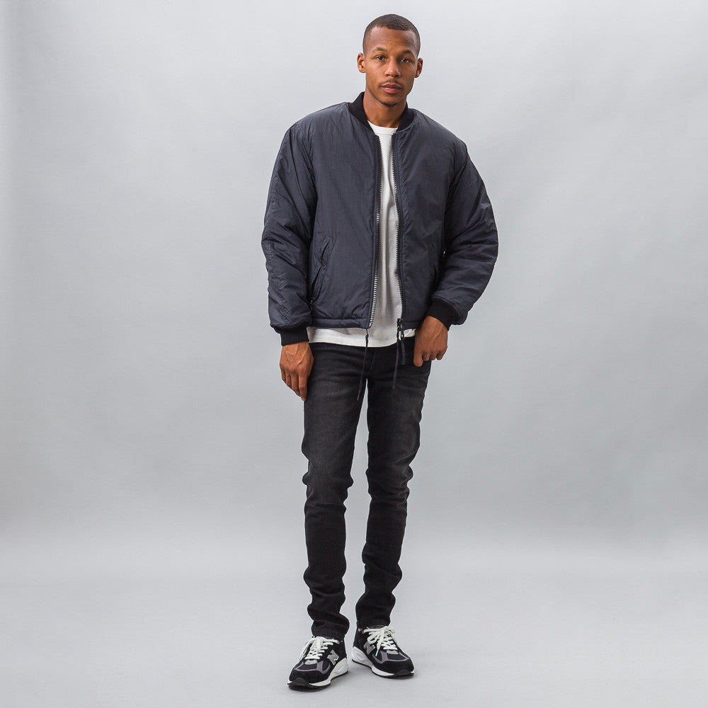 Our Legacy Puffed Bomber in Navy Coating Model Shot