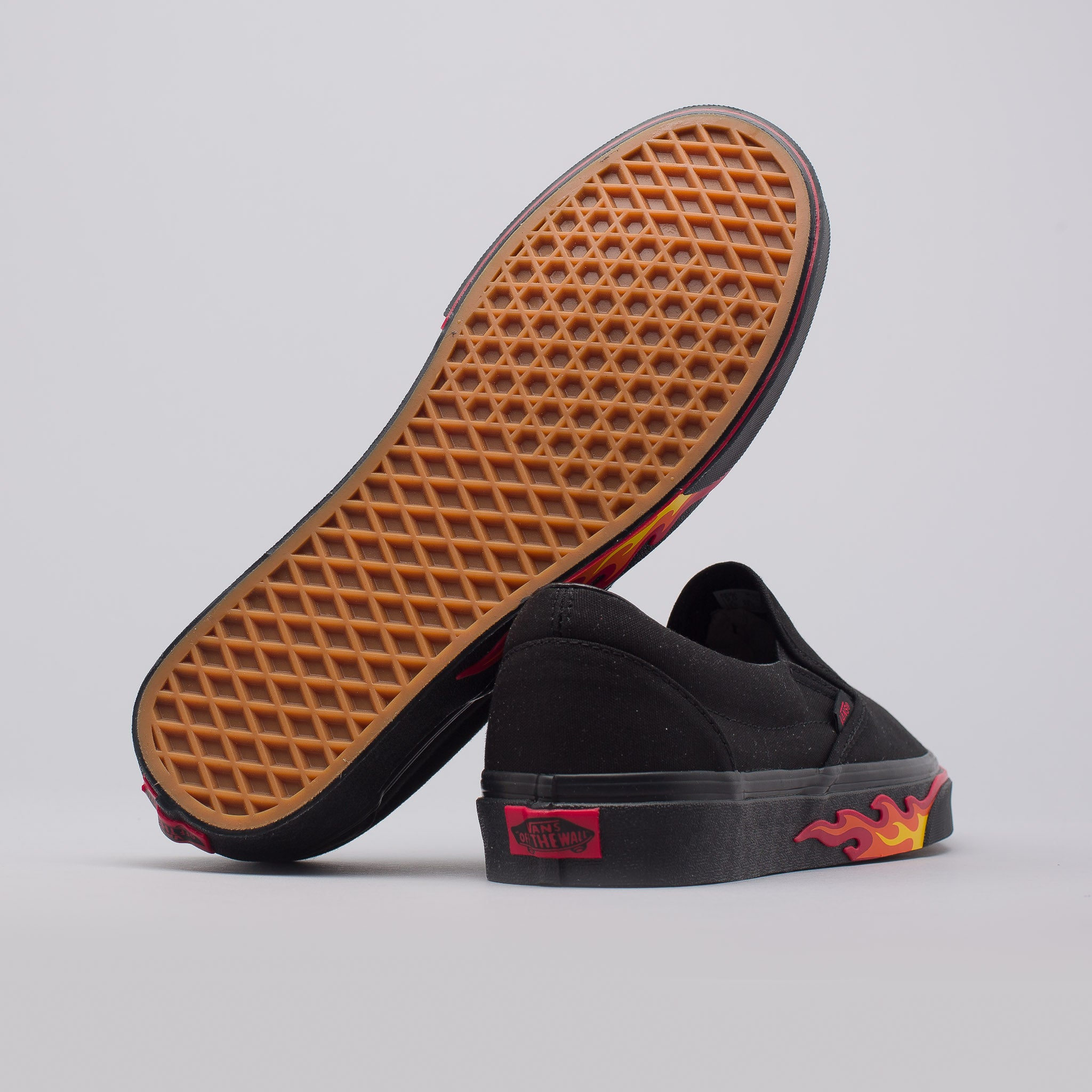 vans slip on black and brown