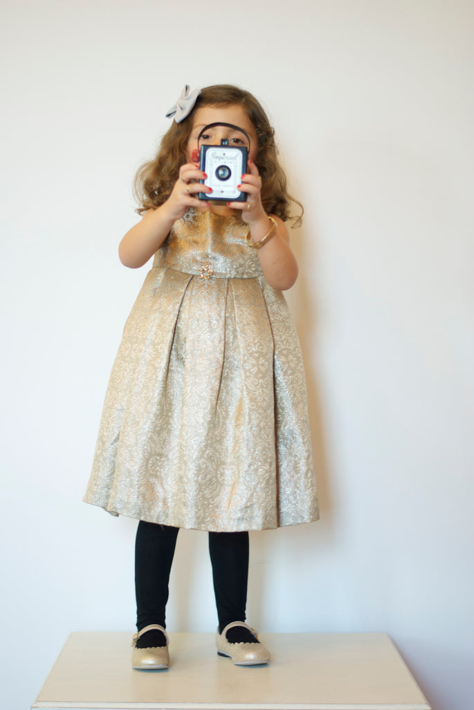 vintage style little girl with gold shoes