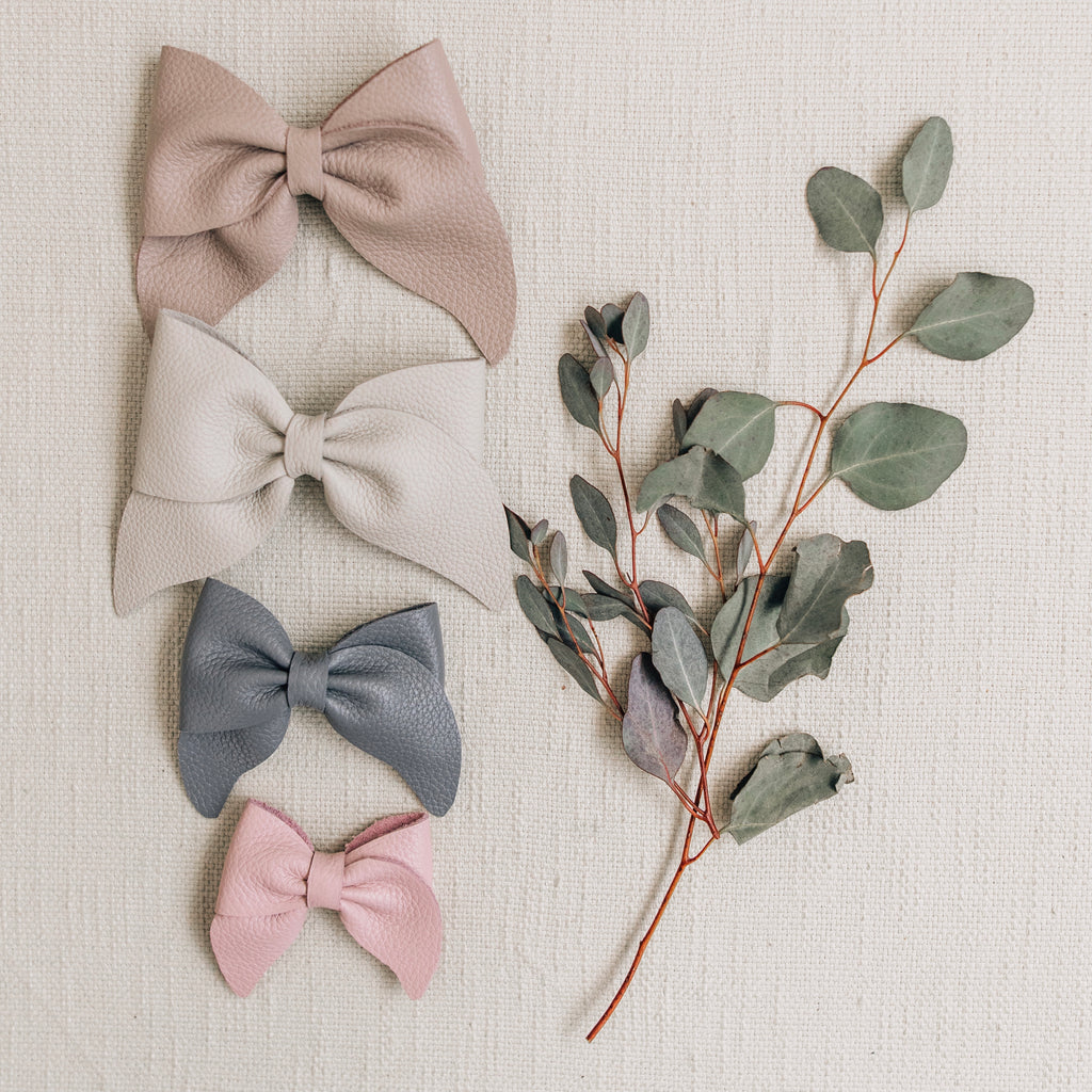 leathers bows featured in color sand, fog, heron, and peony