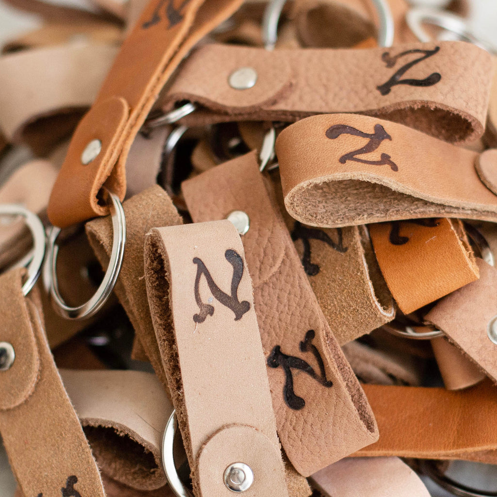 upcycled leather keychains in various shades of brown