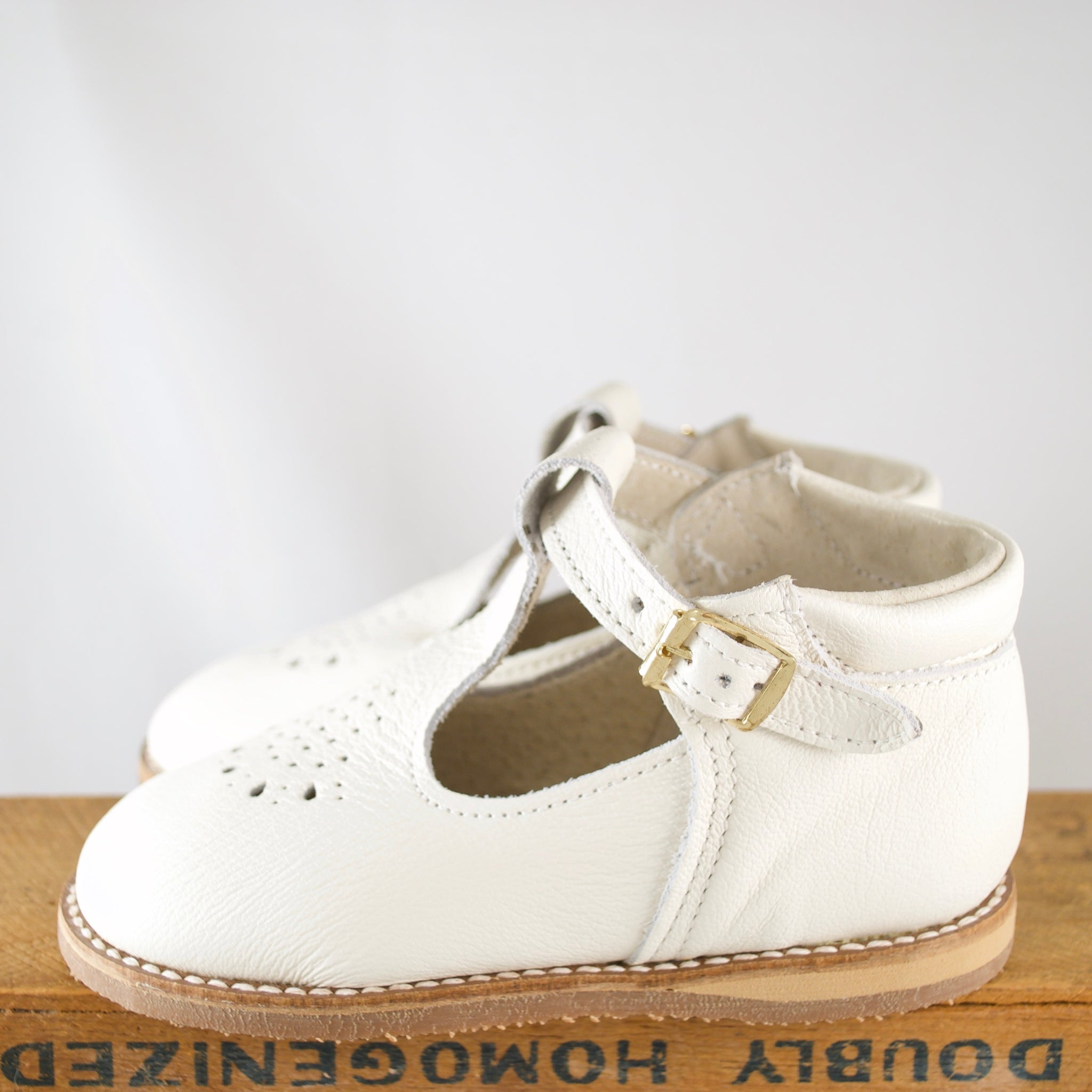 greta t-strap in ivory, pearlized leather