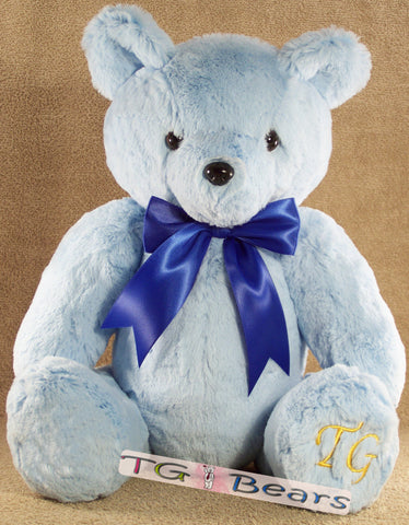 Bubblegum Bear is a handmade teddy bear in the softest pastel blue fur.