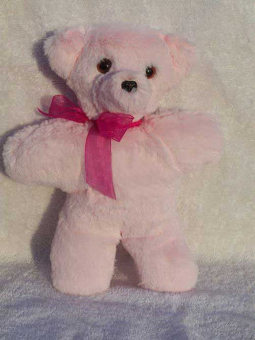 Little Cherry Bear is a small bear in soft pink fur