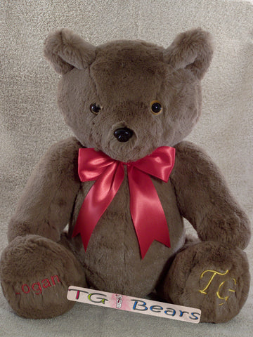 Handmade teddy bear Hernando with a red ribbon