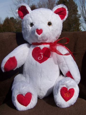 Juliet Bear is a romantic white bear with a customizable red heart