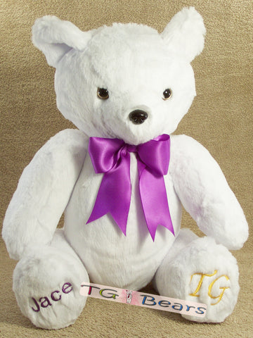 Knut Bear wearing a purple ribbon.
