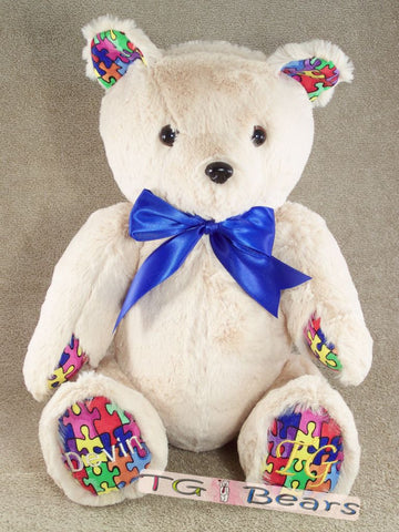 Logan Bear with autism puzzle piece accents