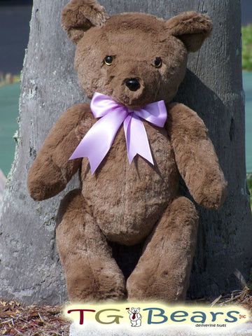 Merlena Bear with a lavender ribbon