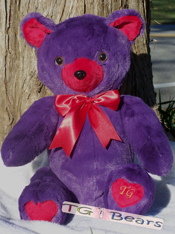 Valentine Bear with purple fur and hearts on her feet.