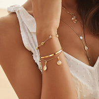 Cowrie Gold Charm - Wanderlust + Co