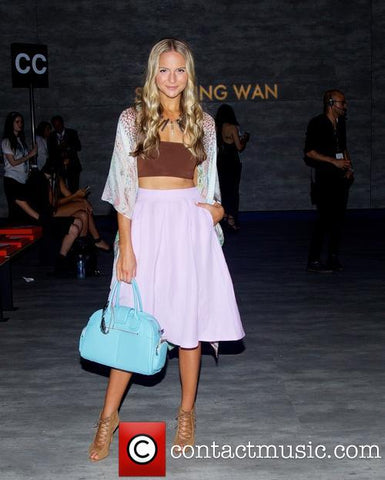 Jackie Miranne with baby blue Glass Handbag Classic satchel at New York Fashion Week