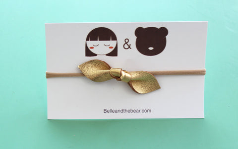 Bow headband in Gold
