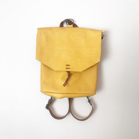 Convertible backpack / crossbody in Mustard