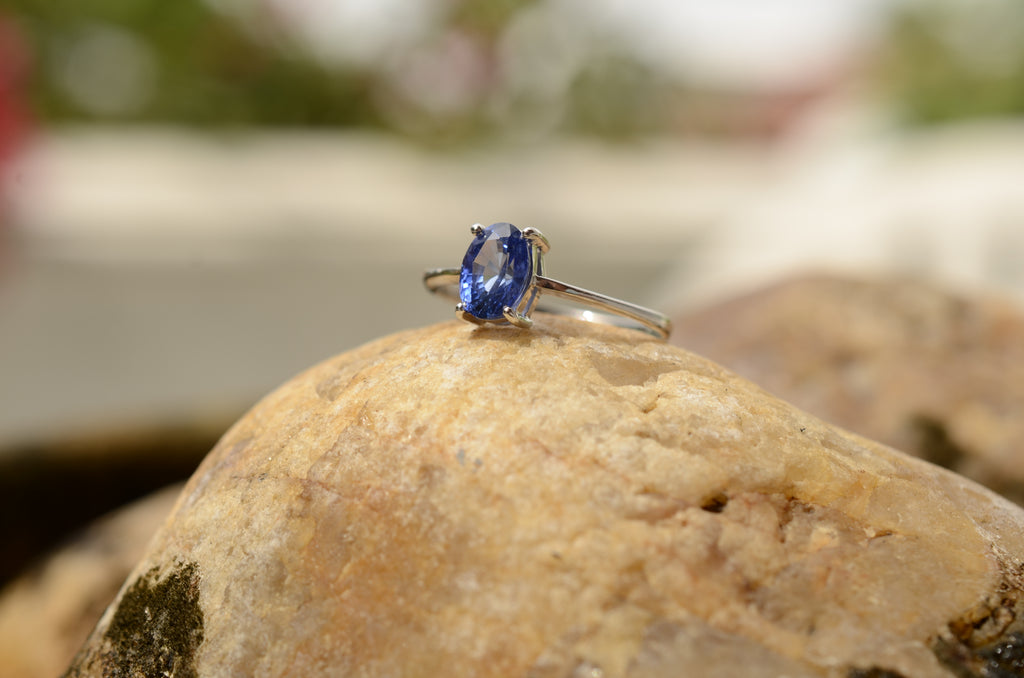 blue sapphire ring on rock