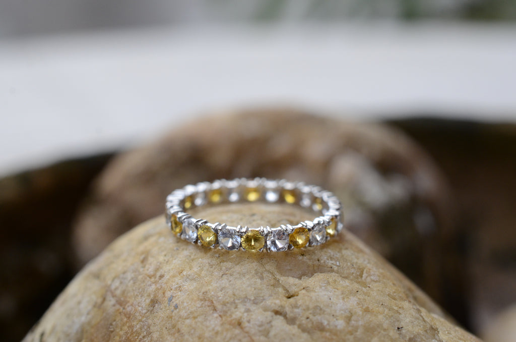 yellow sapphire and diamond eternity ring
