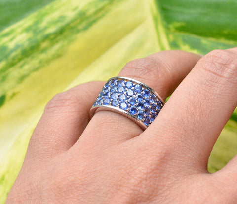 Blue sapphire ring or a thick wedding band made with 18K white gold