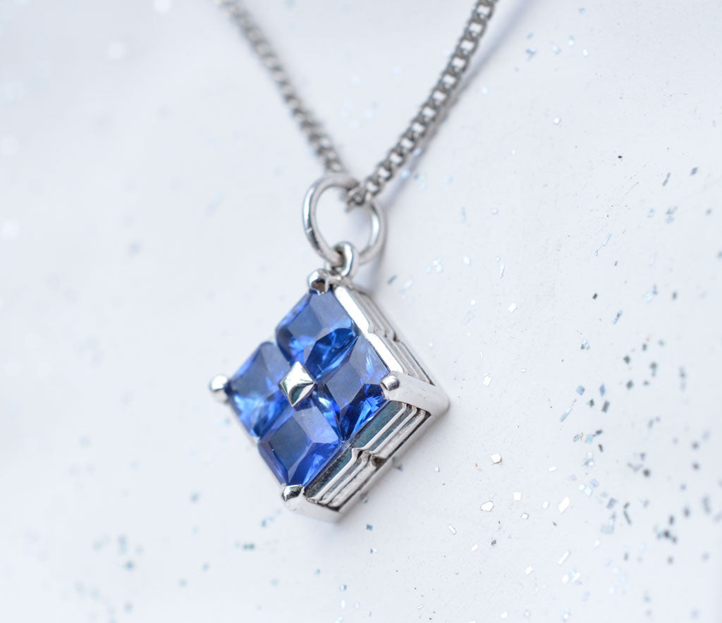 18k white gold square pendant studded with princess cut ceylon blue small square sapphire pendant with princess cut ceylon blue sapphires aloadofball Choice Image