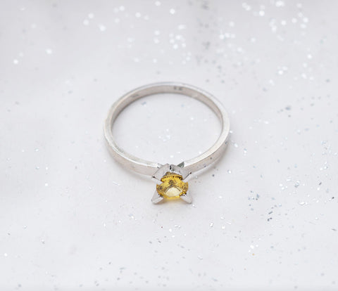 White gold ring featuring natural yellow sapphire