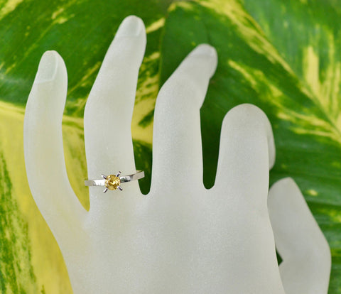 Solitaire yellow sapphire ring in white gold prong setting