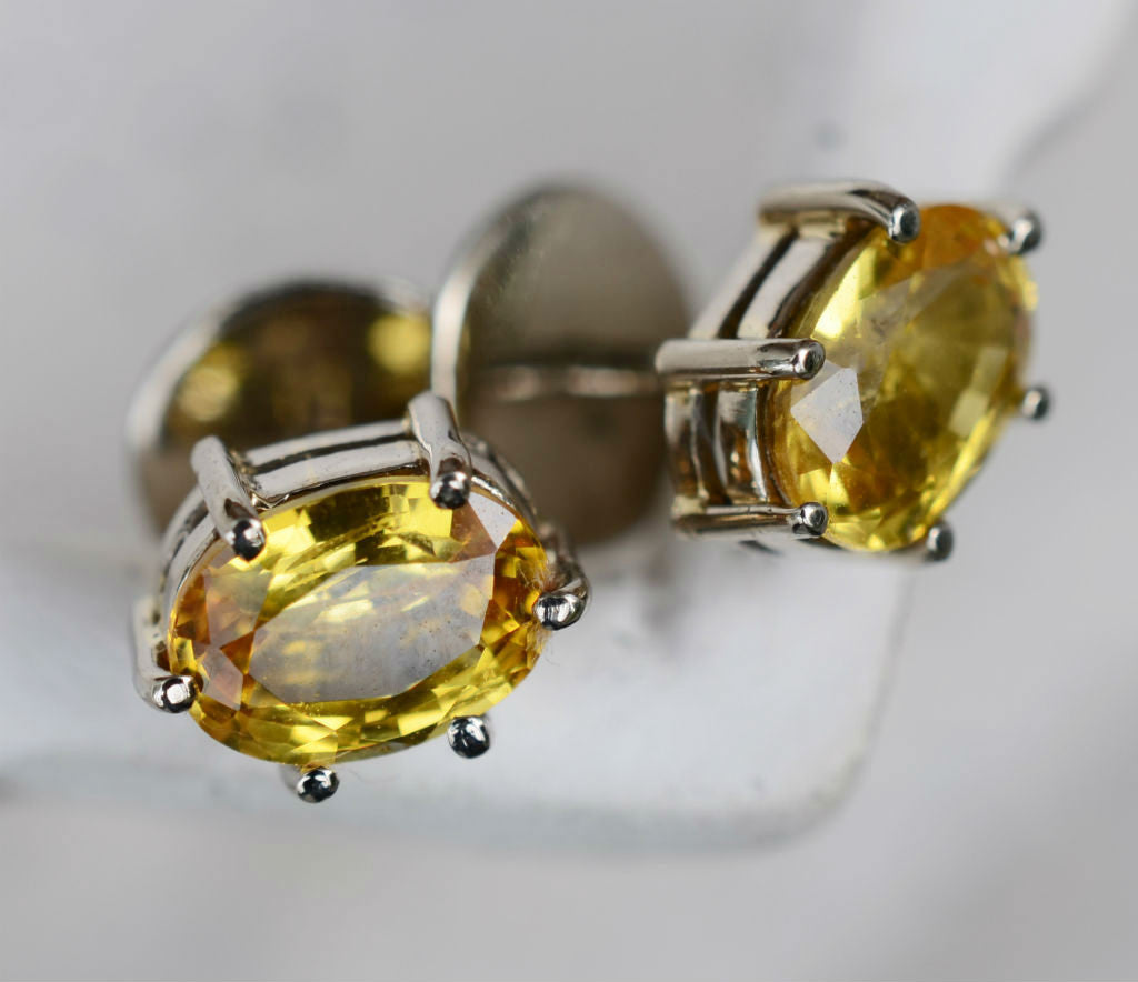 Oval Ceylon yellow sapphire earrings in 18K yellow gold available at Elizabeth Jewellers in Sri Lanka
