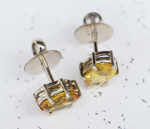 Oval Ceylon yellow sapphire 18K yellow gold earrings available at Elizabeth Jewellers in Sri Lanka
