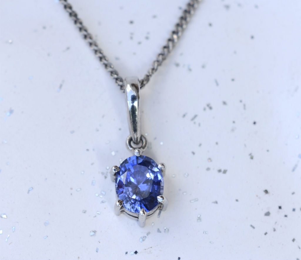 Natural oval Ceylon blue sapphire pendant in 18K white gold available at Elizabeth Jewellers in Sri Lanka