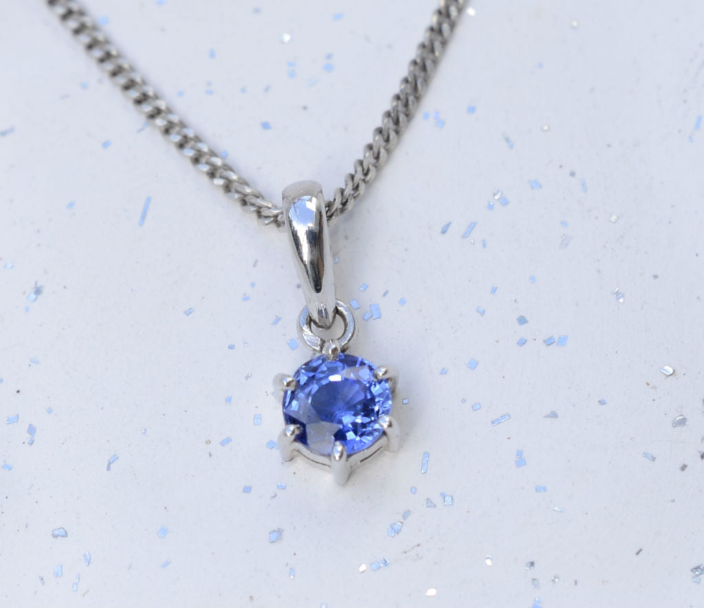 Natural round Ceylon blue sapphire 18K white gold pendant available at Elizabeth Jewellers in Sri Lanka