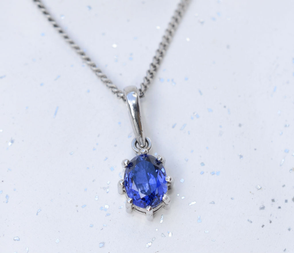 Natural oval Ceylon blue sapphire 18K white gold pendant available at Elizabeth Jewellers in Sri Lanka