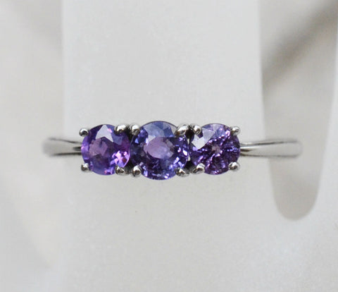 3 Natural Ceylon Purple Sapphires prong set on 18K white gold ring available to buy at Elizabeth Jewellers in Sri Lanka