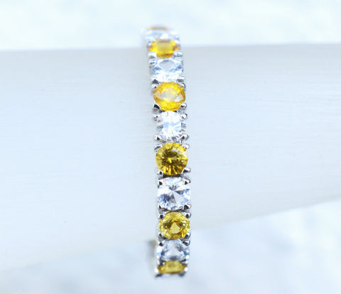 Natural Ceylon Yellow and White sapphire eternity ring in 18K white gold