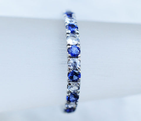 18K white gold Ceylon blue and white sapphire eternity ring perfect for a wedding ring.