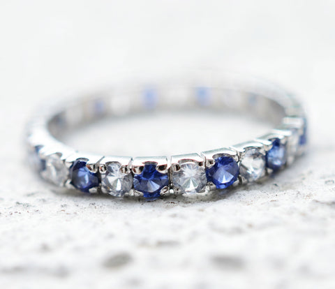 Ceylon blue and white sapphire 18K white gold eternity ring perfect for a wedding ring.