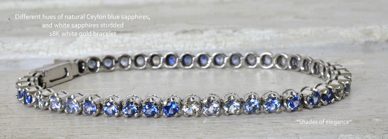 Single line sapphire bracelet with shades of natural Ceylon blue sapphires and white sapphires