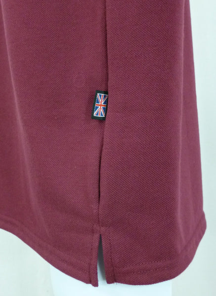 Burgundy polo shirt, side vent detail