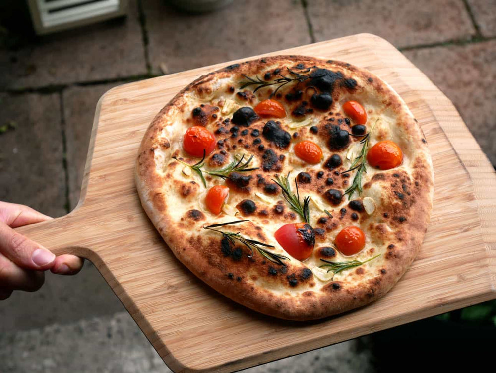 Focaccia pizza with cherry tomato and rosemary