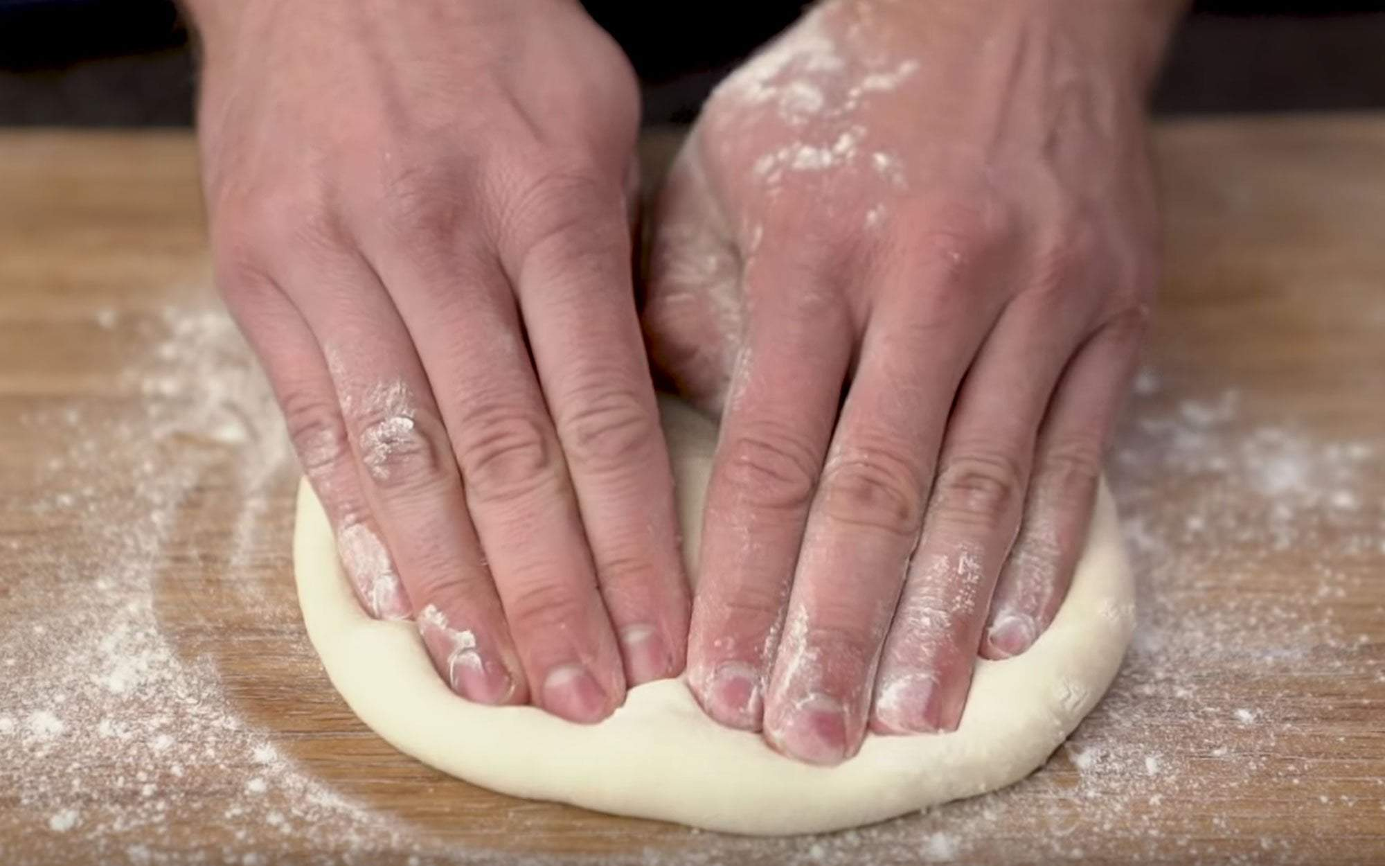 4 Easy Steps for Stretching Pizza Dough Featured Image
