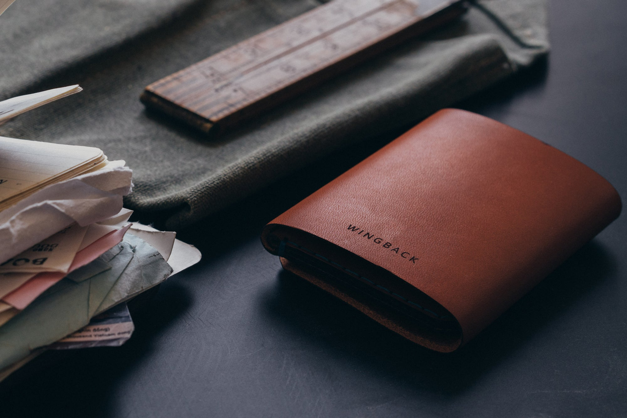 Slim leather wallet in cognac by Wingback