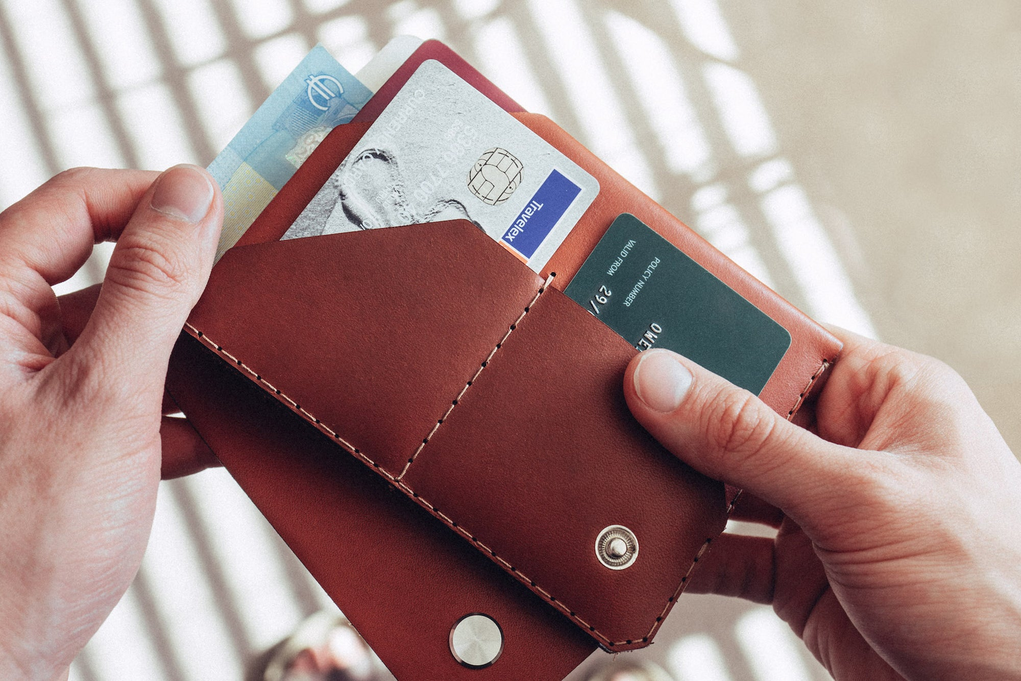 Personalised leather travel wallet in cognac by Wingback