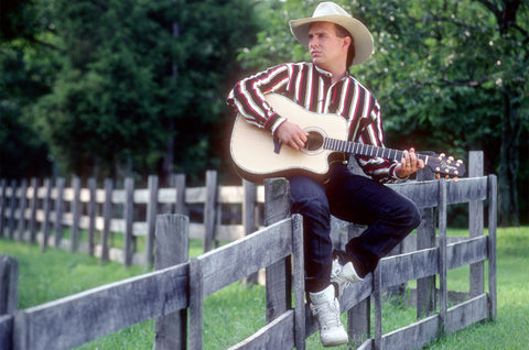 Garth Brooks on a fence