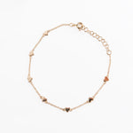 WD477, 14kt gold thin chain bracelet detailed with 7-hearts