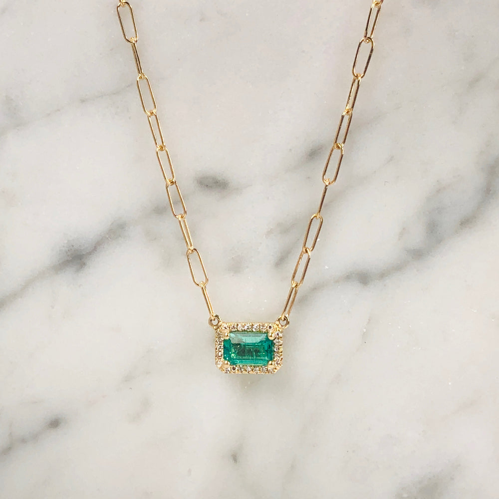 WD645 A highly demanded stone, the emerald .59ct with .12ct diamond halo. The open link chain gives the modern look but can be enjoyed for years.