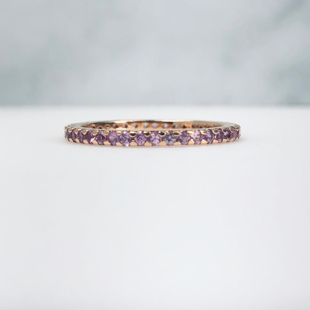 AD121PS - Pink Sapphire Shared Prong Eternity Band