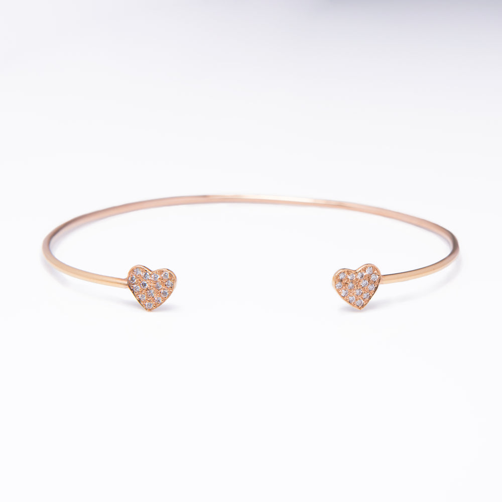 WD181, 14kt gold thin cuff with pave set diamond hearts deatil on each end