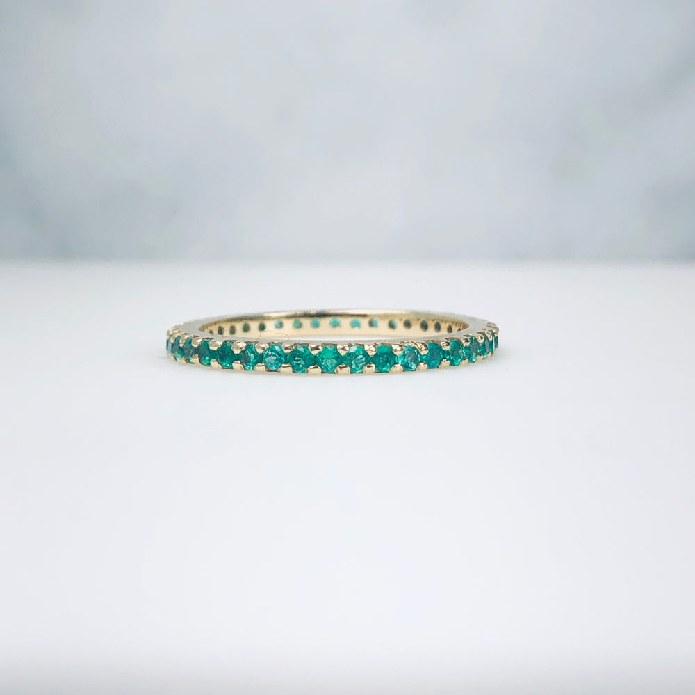 AD121E - Emerald Shared Prong Eternity Band