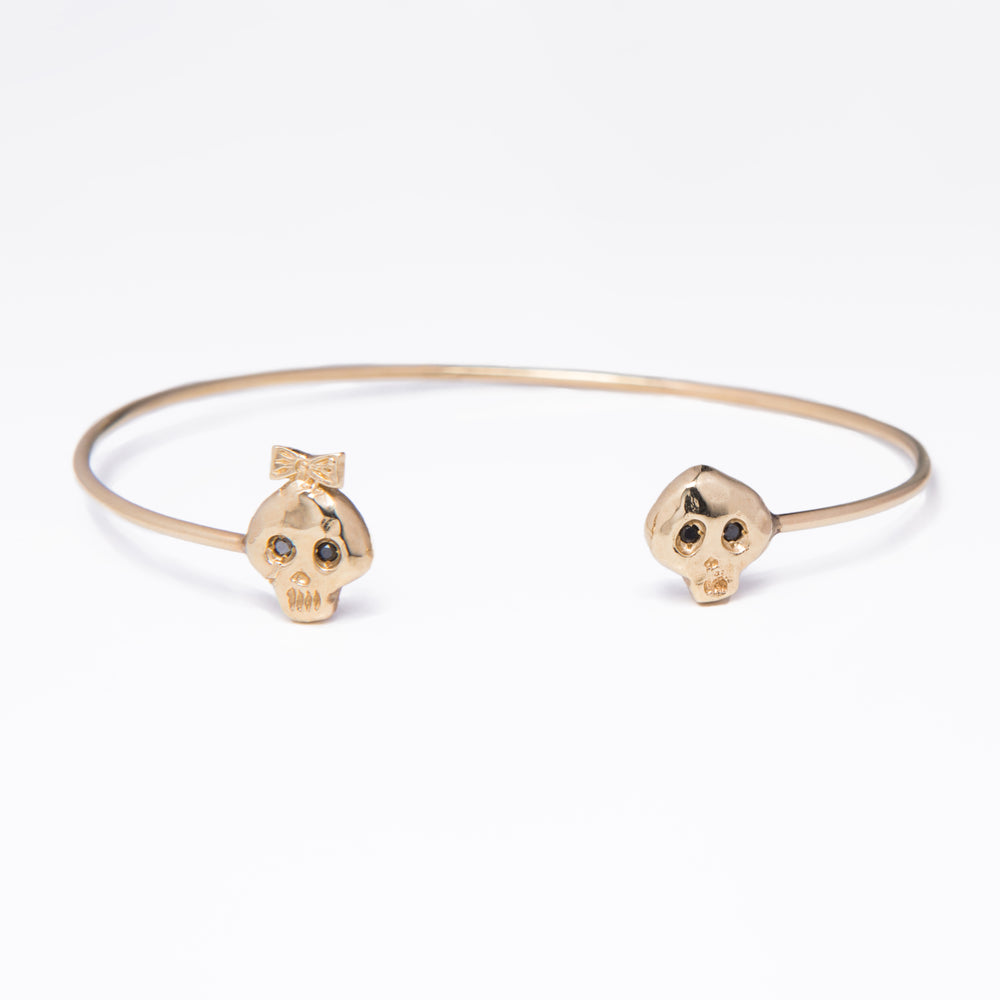 WD166 14kt gold girl and boy skull cuff