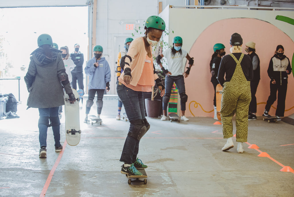 The Colour the Trails organization leads a skateboarding class