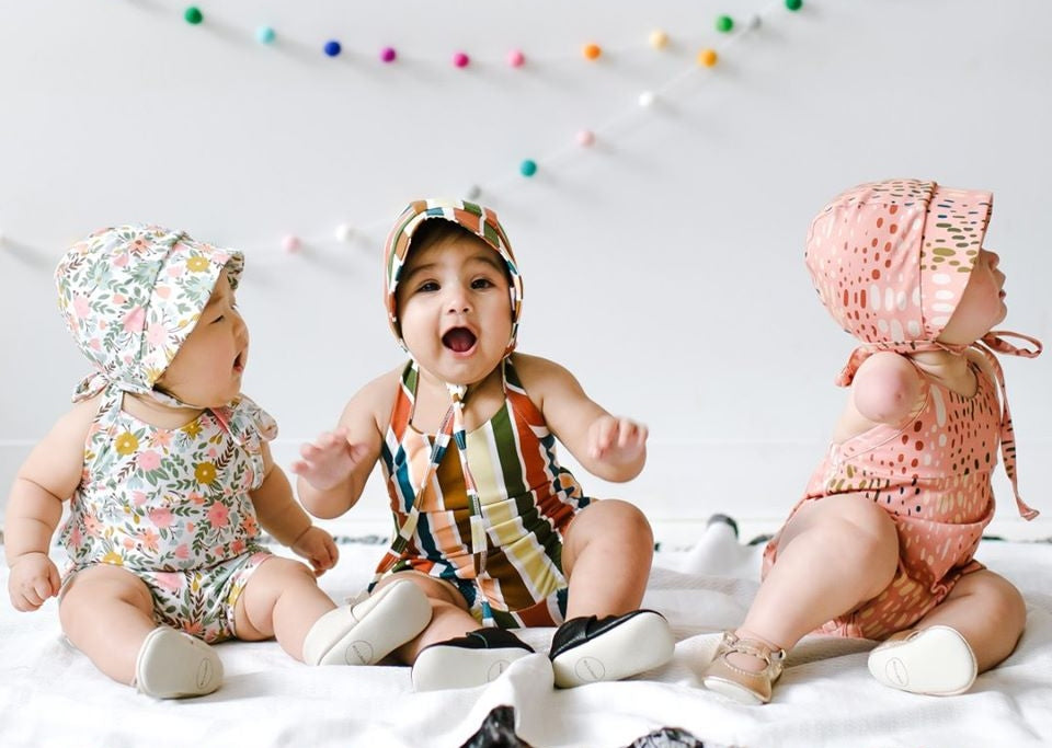 Three adorable happy babies in Little & Lively spring sunbonnets